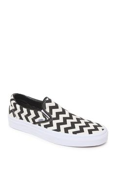 A PacSun.com Online Exclusive! The women's Chevron Slip-On Shoes by Vans offers a bold chevron print in black and white along with cozy comfort. We love wearing these slip-on shoes for women with our denim and basic t-shirts for cool, casual style! These slip-on shoes have a white rubber sole and padded interior.	Imported