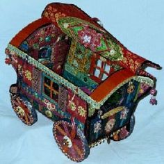 A soft sculpture Gypsy Wagon pattern - this pattern is near the bottom of the page. Scroll past the gorgeous soft sculpture doll patterns....if you can! :)