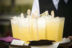 """The groom's signature cocktail was """"honey Hole Punch."""" Beverages were personalized with custom wooden drink stirrers featuring the couple's names. #signaturecocktail #woodenstirrers Photography: Melissa Mermin 