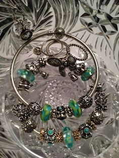My blue and teal flower Pandora collection! Nicole