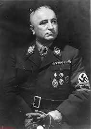 Robert Ley (15 February 1890 – 25 October 1945) was a Nazi politician and head of the German Labour Front from 1933 to 1945. He committed suicide while awaiting trial at Nuremberg for war crimes.