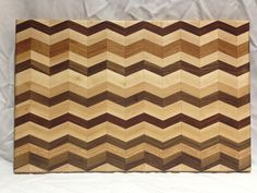 Another chevron herringbone cutting board.  Dual sided.  One with the herringbone design and the other all Maple hardwood.  So you can cut on one side and display on the other.  By far, it is our most popular design since we've started.  $85.00  #repurpose #upcycle #herringbone #chevron #cutting board Chevron, Pattern Cutting, Wood Glass, Herringbone Pattern, Cutting Boards, Wood Working, Repurposed, Upcycle, Hardwood