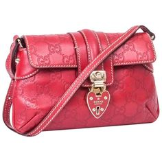 9238504b08f GUCCI Mini Bag in GG Embossed Red Leather