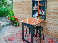 Love to entertain, but don't have space for a permanent bar? Build a foldaway table and cabinet so you'll be ready for a party at any time. We built ours for the patio, but it can be hung indoors too.