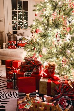gorgeously wrapped gifts - what a cozy space by the tree!