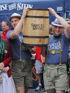 It's all about the beer at Oktoberfest Zinzinnati. Photo: Brett Jula and Brandon Colt brought the keg onto Fountain Square for the official tapping at Oktoberfest Zinzinnati 2013. Enquirer file photo