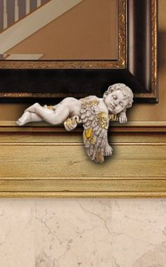 "Antique Gold Patio Wall Angel Figurine Buy Patio Decor Angels!  -  So peaceful an baby angel can have a nap.  Sit it . Place it on a patio wall, window ledge, fireplace mantel or anywhere you want to create a peacefully ""at home"" feeling.  Orders Call: 1-800-417-9872"