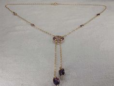 14K yellow gold amethyst necklace. There are 10 natural amethysts along the chain links of this unique piece. The necklace measures 16 inches long,
