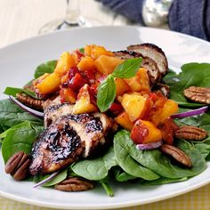 Peach and Basil Salsa on Blueberry Barbeque Chicken Spinach Salad - bright, fresh, colorful, seasonal, nutritious and downright delicious. Everything you want in a healthy salad plus the fruit salsa acts as an oil-free dressing.
