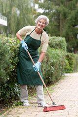 Senior with broom
