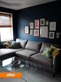 Navy blue walls by aurora Grey sofa. Pops of colour. Nice basem