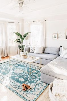 I like this shade of blue & the rug as the statement piece surrounded by neutrals.