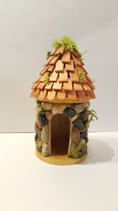 This adorable fairy house is made of a refurbished birdhouse.  It will be an awesome addition to our next fairy garden.[media_id:3316599][media_id:3316603]�