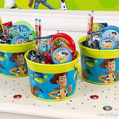 Just add some Toy Story goodies and candy to Toy Story Favor Buckets and give them out to all your guests.