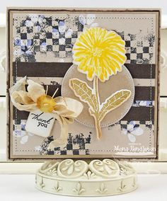 Dandelion Wishes; Distressed Background Blocks; Peaceful Wildflowers; Dandelion Stems and Toppers Die-namics; Blueprints 3 Die-namics; Notched Tag Die-namics; Delicate Doily Stencil - Mona Pendleton