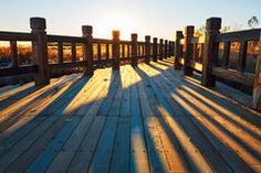 The wooden trestle and shadows sunset Stock Images