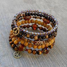 Boho chic - Amazonite, Tiger's eye, howlite, African trade beads, Turquoise, Onyx, and wood beaded bangle yoga jewelry. $98.00, via Etsy.