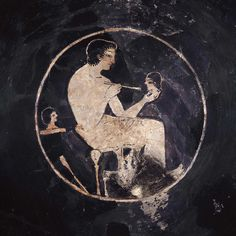 Drinking cup (kylix) with man painting a head | Museum of Fine Arts, Boston