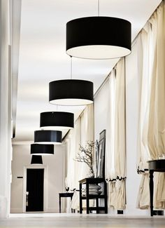 Hallway/Foyer - Black drum shade light fixtures all in a row.  This space can carry these shades very easily.  (re-pinned photo from Malene-birger)