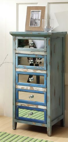 Tallboy dresser with mirrored drawers // love this   furniture design