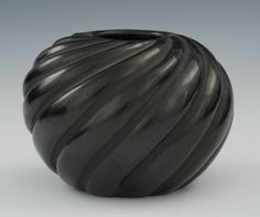 """A Santa Clara Pueblo Blackware Vase by Madeline Tafoya The graceful rounded form has deeply carved swirls around the sides, standing . 3-3/4""""H x 5-1/2""""D, signed on the underside """"88...Madeline T...Sta. Clara Pue."""""""