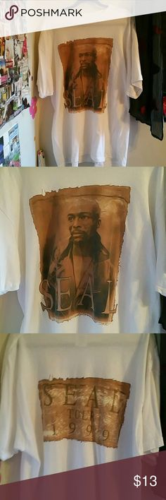 Vintage Seal 1999 Concert Tee XL He is my favorite singer....I was planning on being able to wear this again someday. I own every one of his albums, I'm such a geek! :) I bought this, wore it twice, then gained a lot of weight. I weep. Somehow I put a hole in the right armpit as shown. Otherwise this is in really good shape. No other rips, stains or tears. You can sew it, but price reflects damage.  100% cotton Tops Tees - Short Sleeve