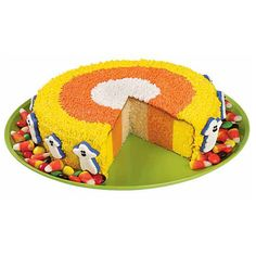 Ever imagine How Candy Corn is Born? Here?s one explanation! Checkerboard Cake Pan rings are used to bake the 3-color cake layers. When you slice cake into wedges, they?ll look like giant pieces of candy corn!