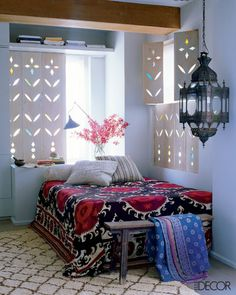 Suzani bed spread, Beni Ourain rug, Moroccan lantern, and incredible shutters. This room is everything