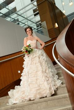 Hilton Columbus Downtown - a brand new, contemporary #wedding venue located between the Short North and downtown #Columbus.    Gown provided by Big Rock Little Rooster. Makeup by Leigh Ann Ehmann. Flowers from Market Blooms at the North Market.