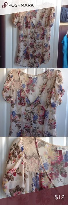 """Floral & lace sheer top. Button down. Size XS Cute, sheer, trendy with jean shorts and cowboy boots. This is a size XS. Gathered little sleeves with cream colored lace at shoulders. Measures approx. 25"""" from shoulders to hem. V-neck. Button down. Love Fire Tops Button Down Shirts"""