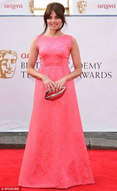 Pretty in pink: Ophelia Lovibond war a vintage-inspire brocade dress and carried a Lulu Gu...