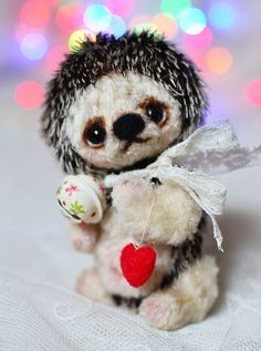 This is my new OOAK Christmas Hedgehog - Fuf . He made from the German viscose and japanese silk. He is 11 cm high(~4 inch). He is stuffed firmly with polyester and metal pellets. He toned oil paints. He is fully jointed, 6 way jointed, double jointed neck. Hedgehog has black glass eyes. He can move his arms, legs and head. He can sit and rest.