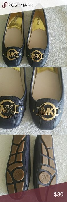BNWOT Michael Kors navy blue and gold flats BNWOT Michael Kors navy blue and gold MK emblem flat shoes. Very pretty and on trend. Michael kors Shoes Flats & Loafers