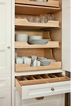 Pull-out shelves for dinnerware.