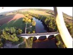 LIMEUIL : CONFLUENT DE LA VEZERE ET DE LA DORDOGNE , prise de vue aérienne réalisée au soleil couchant. Le doré du pont de la Vézère contraste avec le grisé du contrejour du pont de la rivière Dordogne. Au loin en amont de la Vézère, la ville du Bugue, en amont de la Dordogne, Le Buisson de Cadouin........