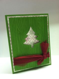 """Such a cute quick & easy Christmas card. You can find the step-by-step tutorial on my blog, peaceloveandjoyce.typepad.com  Features Stampin' Up!'s """"Be of Good Cheer"""" Designer Series paper, the SU Woodgrain embossing folder and the SU Holiday Collection framelits dies."""