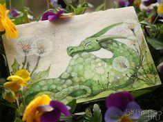 Natural wooden box ornamented with hand-painted green sleeping dragon and dandelions