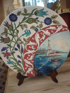 Traditional ceramic plate  crafted by hand with Maiden 's  tower