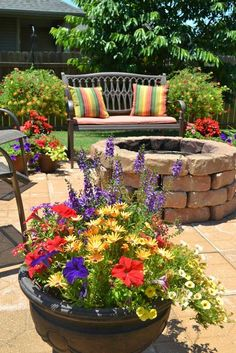 Patio Flowers --- love the colors here and would love to recreate the fire pit in my own backyard.