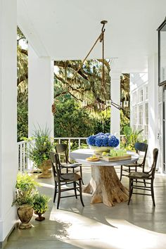 80 Breezy Porches and Patios | Patios and porches are an integral part of Southern culture. These classics are inviting and inspiring. It's no secret that we Southerners live for our porches. Is there any memory sweeter than those of childhood suppers on screened porches, or swinging the night away on the perfectly-designed porch. Face it: we pay for our mild winters with our sultry summers, and while modern air-conditioning may have made those deep porches of the past unnecessary, our…
