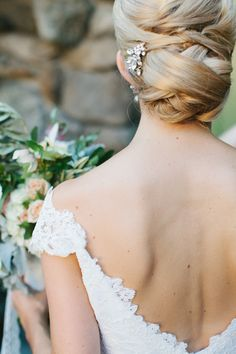 Love this elegant updo perfect for any bride