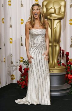 OSCARS, 2009 Aniston attended the awards that year with her then-boyfriend, musician John Mayer, and dazzled on the red carpet in a Valentino Haute Couture gown.