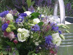 Love this british  summer wedding bouquet.  Cornflowers. Lisianthus, roses, Astrantia