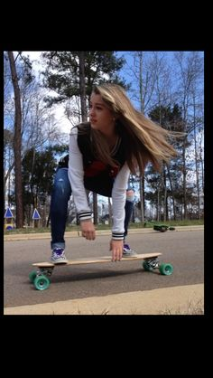 Love her outfit and the longboarding and how her hair flys back love this whole scenery! Great photographer