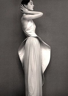 Dovima is wearing an evening gown by Grès, photo by Richard Avedon for Harper's Bazaar, 1950