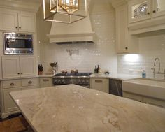 taj mahal quartzite kitchen & Countertops & Quartzite Source by Outdoor Kitchen Countertops, Granite Kitchen, Kitchen Backsplash, Granite Slab, Kitchen Counters, Dark Counters, White Countertops, Bathroom Countertops, Kitchen Cabinets