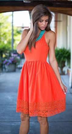 Easy to wear Orange fit and flare summer dress with teal bead necklace. Love this!