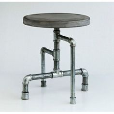 Industrial metal tube and pipe stool with a solid concrete seat. Great around the Detroit Dining Table