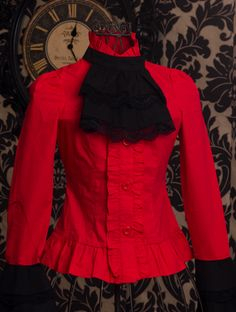 Red fitted women's shirt with black lace ruffled collar piece
