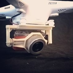 Brand new attachment for the #Lumix GM1 camera on the #Phantom2 - now with tilt servo and video transmitter! Ready to #3dscan some small islands for a student next week:) #3dprint #3dprinted #dji #phantom #drone #dronesaregood @djiglobal #3dprinting @stratasys #uprint #abs #quadcopter #photogrammetry #agisoft #photoscan by tronmikk